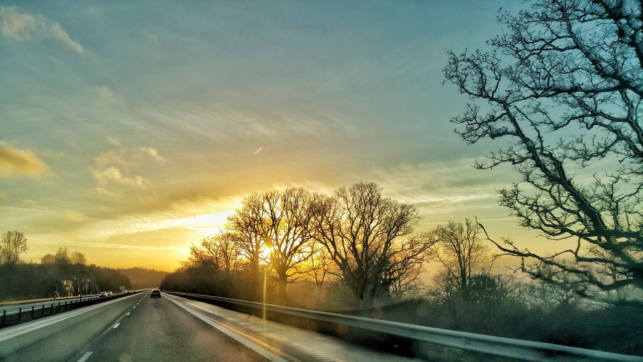 Road Transportation Sunset Tree The Way Forward Highway Car Mode Of Transport Driving Sky Cloud - Sky Outdoors No People Day Tree Beauty In Nature Scenics Tranquility Traveling Home For The Holidays