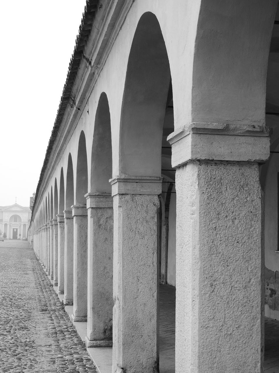 Arcade Arch Architectural Column Architectural Feature Architecture Blackandwhite Building Exterior Built Structure Clear Sky Colonnade Column Day Diminishing Perspective Façade Historic History Low Angle View No People Outdoors Past Prospective Architecture_bw Streetphotography_bw Prospective Photography Prospectives Surface Level The Way Forward