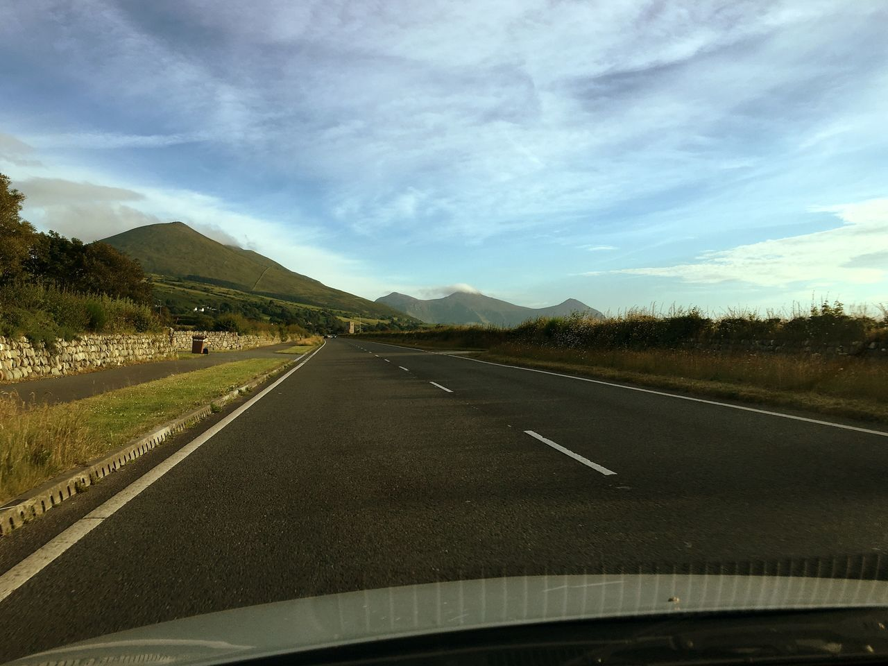 transportation, road, car, the way forward, car interior, land vehicle, car point of view, landscape, no people, mode of transport, windshield, scenics, sky, day, nature, journey, cloud - sky, road trip, travel, outdoors, mountain, tree, beauty in nature