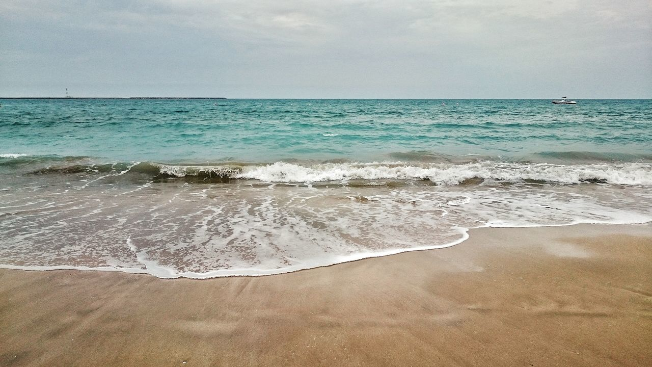 Sea And Sky Beach Sea Sand Water Horizon Over Water Scenics Travel Destinations Beauty In Nature Outdoors Nature Wave Backgrounds No People Vacations Sky Day Calm Water Calm Sea Beach Life UAE EyeEmNewHere