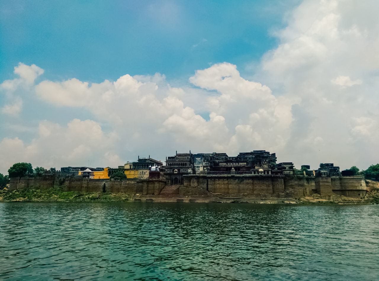 built structure, architecture, sky, cloud - sky, water, building exterior, waterfront, day, river, outdoors, no people, nature, beauty in nature, city