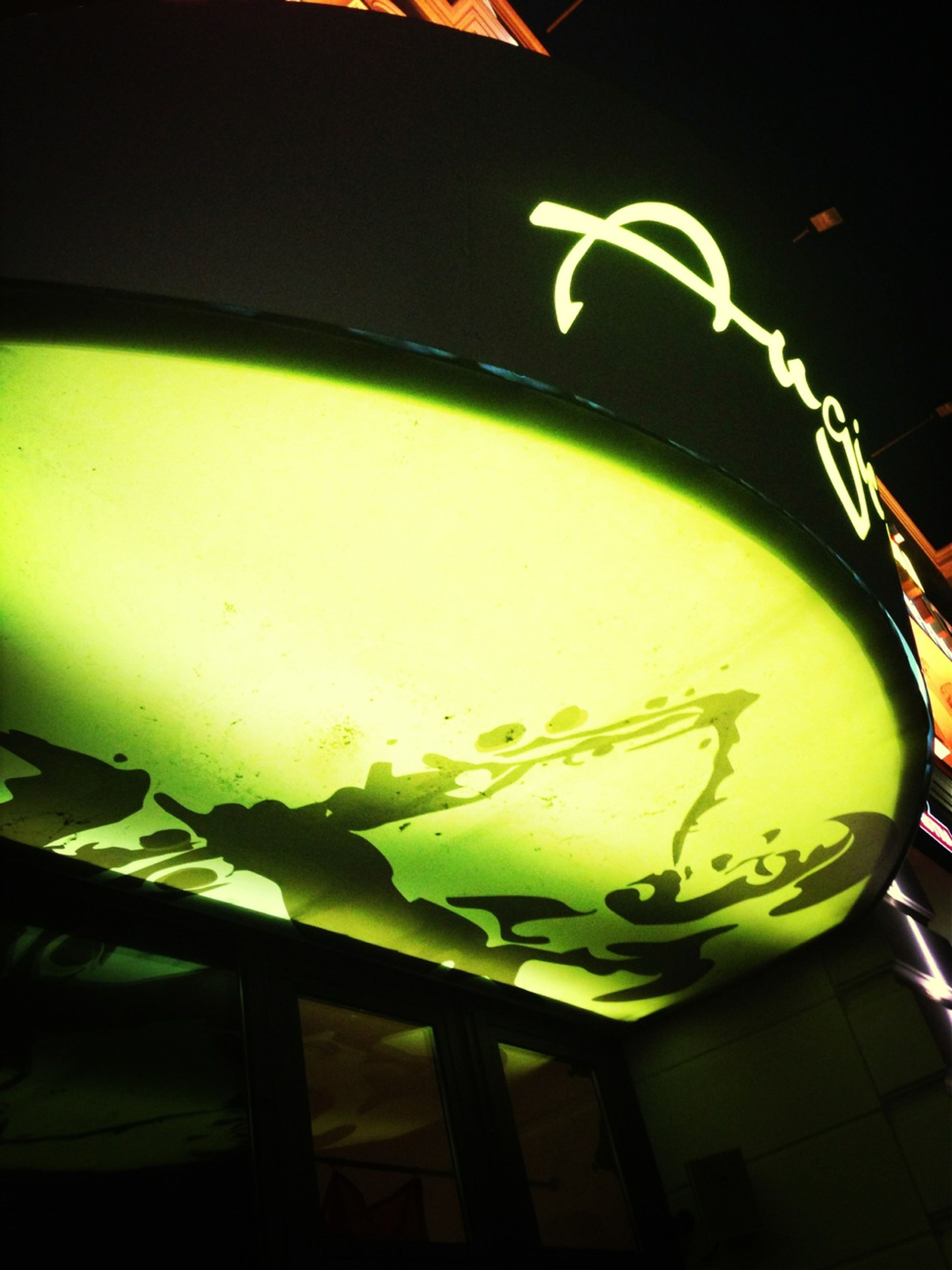 indoors, close-up, food and drink, text, part of, cropped, night, illuminated, no people, drink, communication, glass - material, green color, yellow, high angle view, western script, still life, focus on foreground