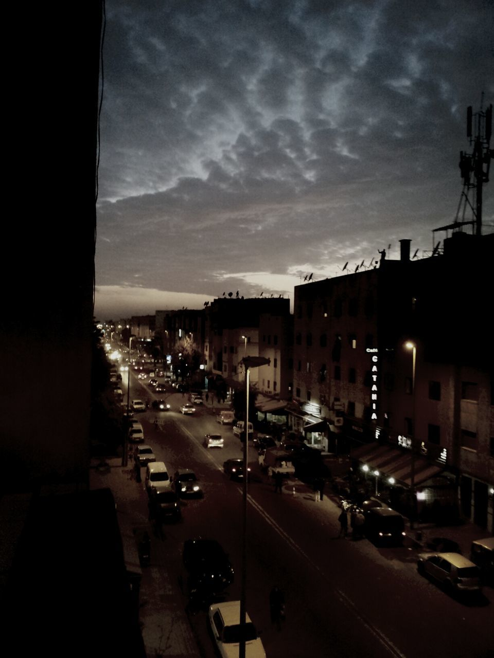 car, sky, cloud - sky, transportation, land vehicle, built structure, building exterior, architecture, illuminated, night, mode of transport, no people, outdoors, city