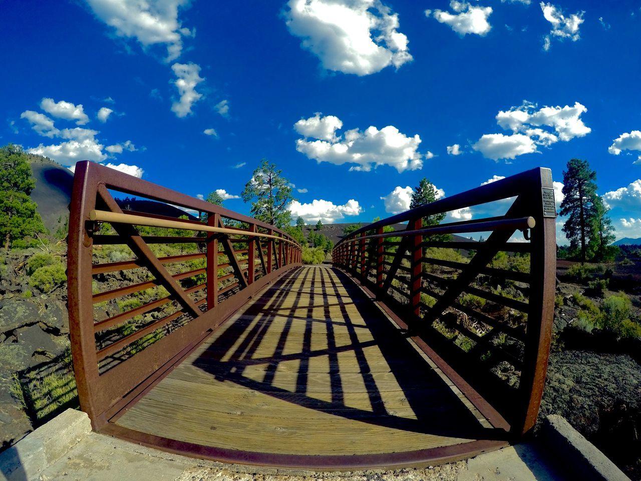 Footbridge Against Cloudy Sky