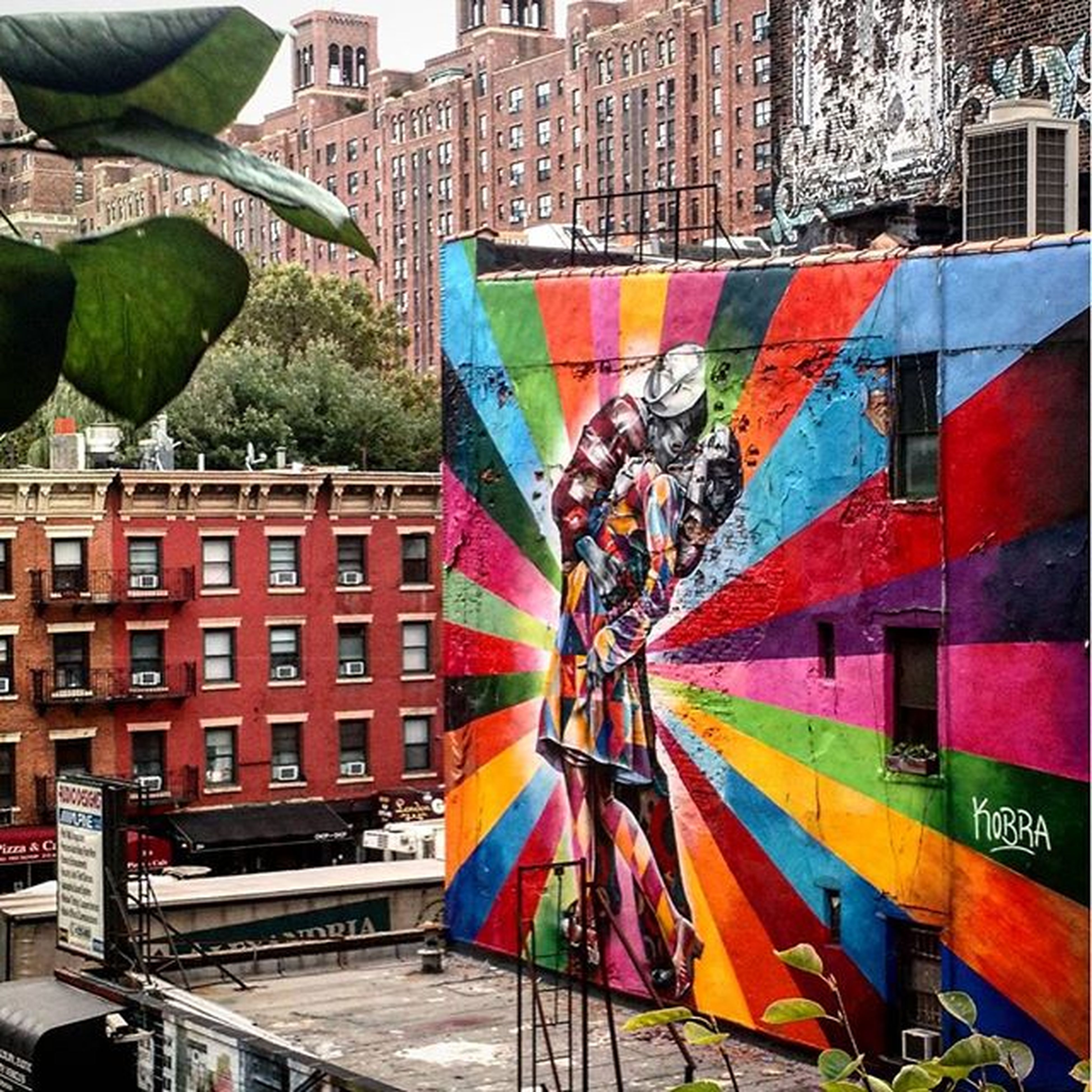 building exterior, architecture, built structure, graffiti, multi colored, art, creativity, art and craft, building, city, residential structure, outdoors, residential building, day, colorful, wall - building feature, street art, no people, text, house