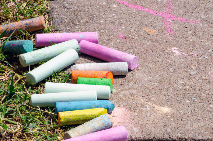 colorful sidewalk chalk is ready for small hands to create a masterpiece Fun Sidewalk Chalk Close-up Colorful Create Createcommune Day Drawing For Kids High Angle View Kids Toys Multi Colored Outdoors Sidewalk Chalk Tool
