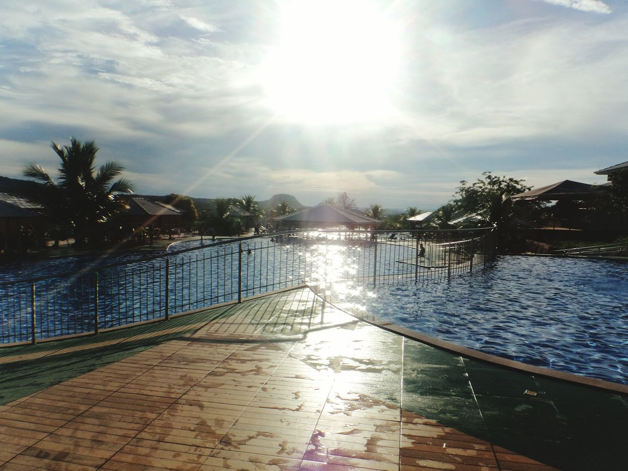 water, sky, sunlight, swimming pool, scenics, cloud - sky, tranquility, tranquil scene, sea, beauty in nature, nature, outdoors, palm tree, no people, tree, sun, day, mountain, architecture