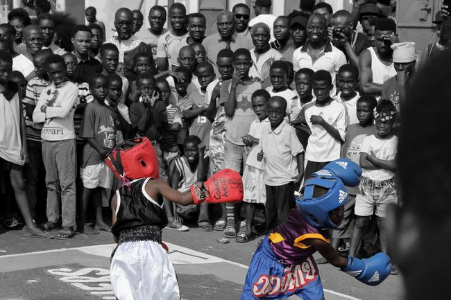 Kid Boxers Fighting Like Men. Young Ghanaian kids boxing at the Chale Wote street art Festival in Jamestown, Accra. Black & White Blackandwhite Blackandwhite Photography Blue Boxer Boxing Chalewote Chalewote2016 Children Fight Fighting Ghana Kids Red Street Streetart Streetfighter Streetphotography Young Eyeemphoto Two Is Better Than One