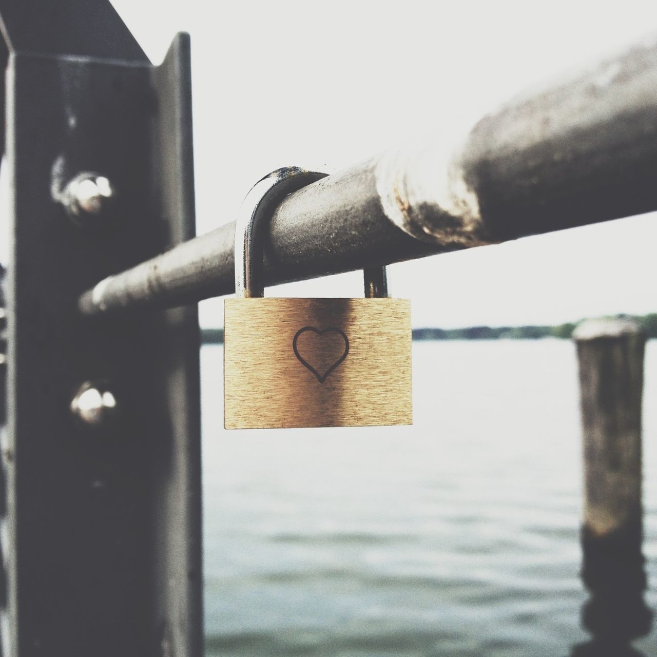 Close-up of a love padlock hanging on railing