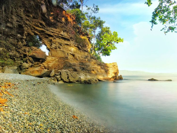 Nature Rock - Object Beach Water Outdoors Sea Sand Beauty In Nature No People Landscape Sky Day Scenics Horizon Over Water Tree EyeEm Nature Lover EyeEmNewHere EyeEm Best Shots EyeEmBestPics AmbonIsland Nature Swimming Cloud - Sky Beach Day Long Exposure Perspectives On Nature