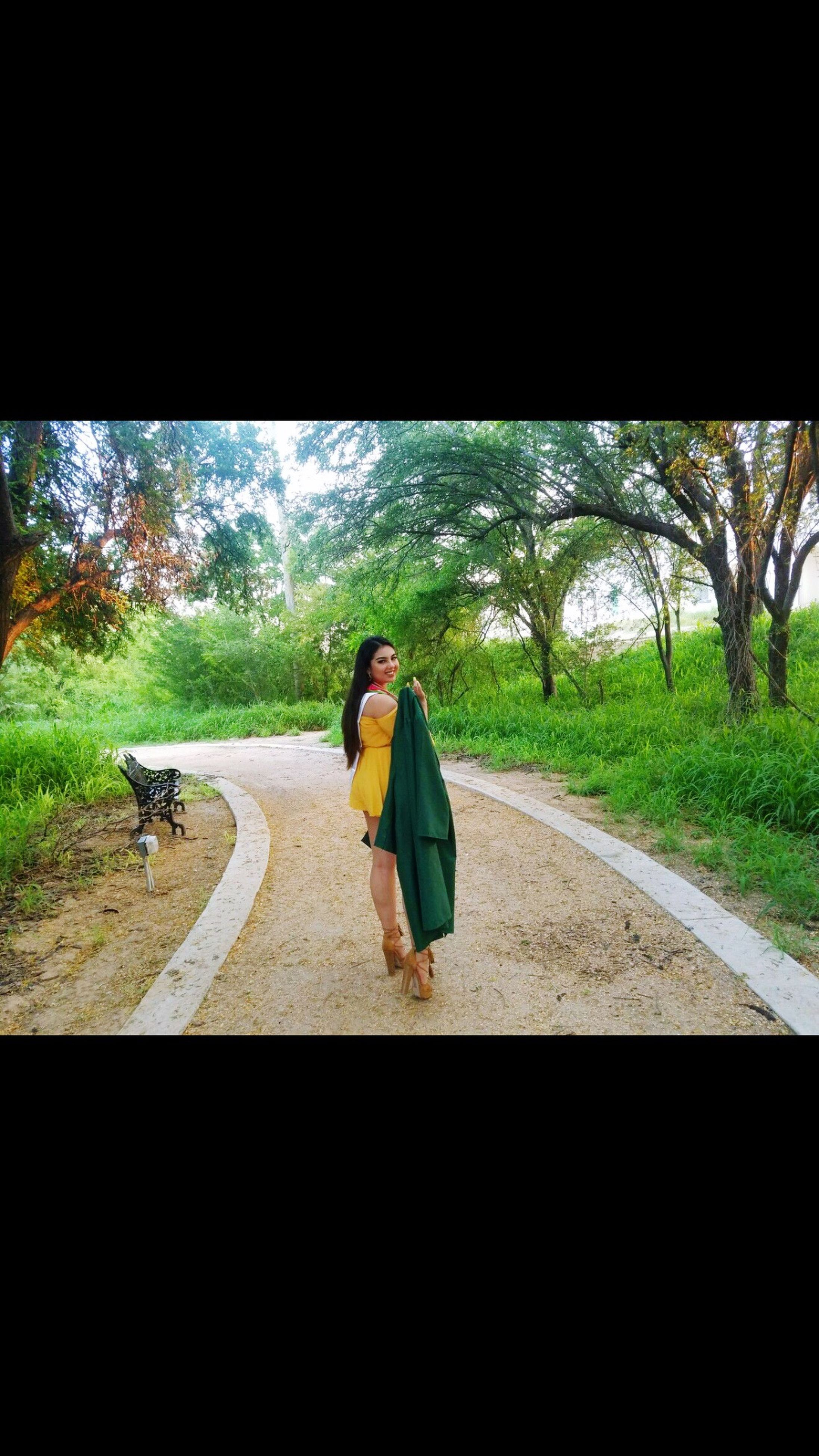 road, transportation, walking, full length, one person, rear view, tree, day, the way forward, adult, one animal, young adult, real people, outdoors, one woman only, women, only women, adults only, people, one young woman only, young women, sky, mammal