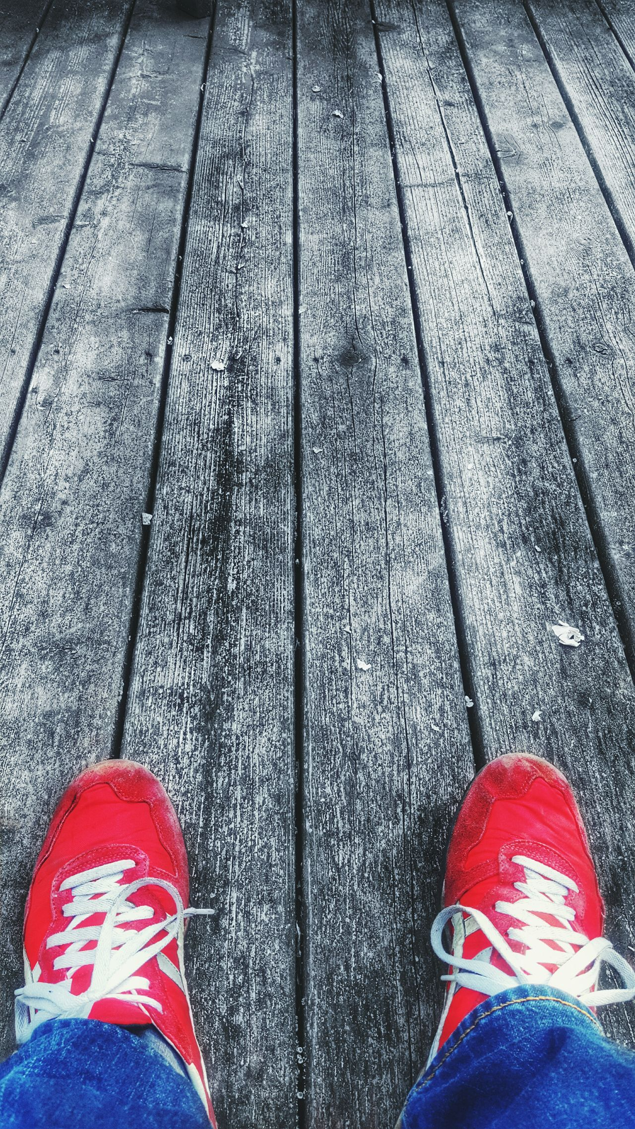 A beautiful afternoon Enjoying The Sun Deck Red Shoes Red Colorsplash Wood Black And White Shoes Boards These Shoes Have Taken Me Everywhere First Eyeem Photo Relaxing Porch