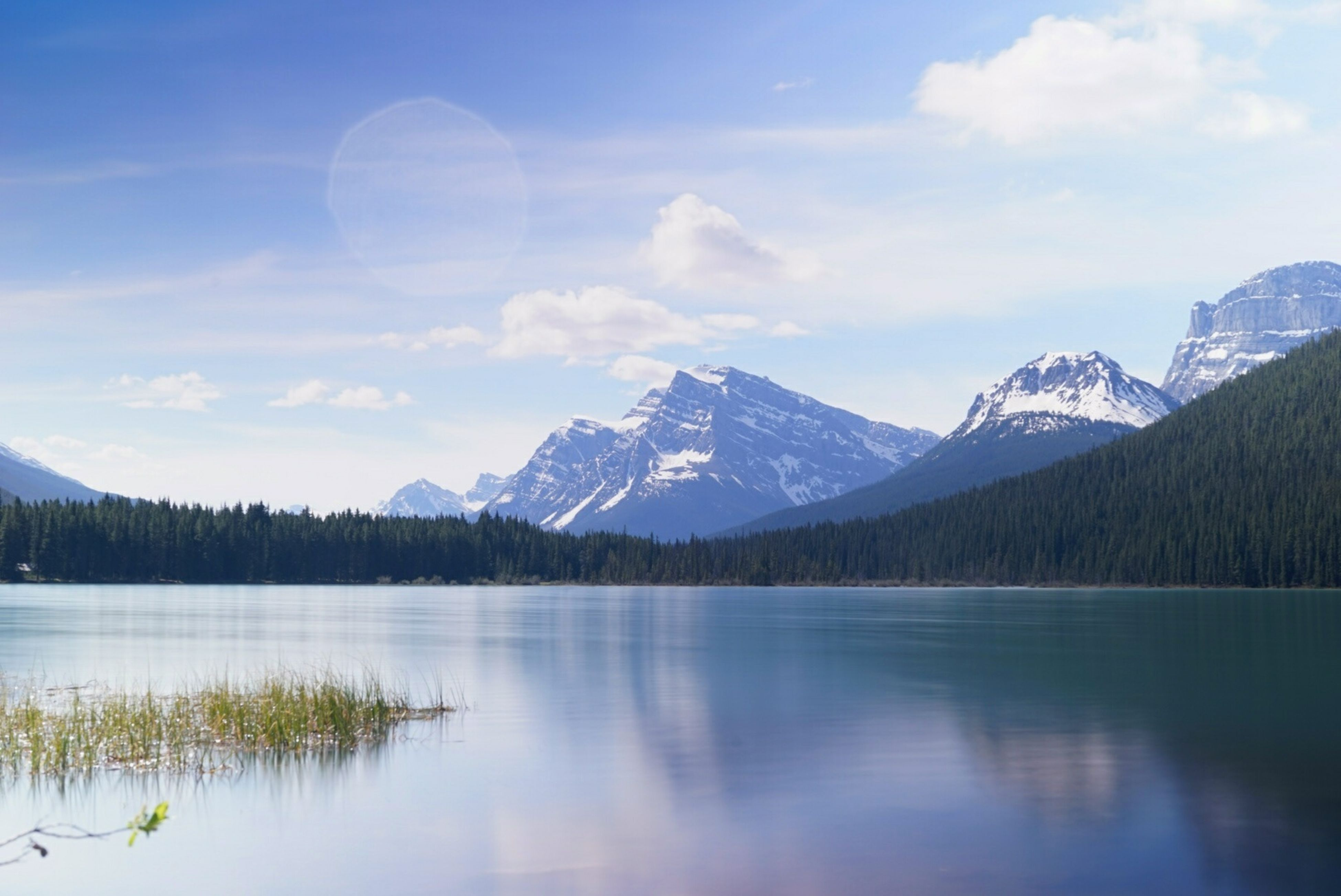mountain, mountain range, tranquil scene, lake, tranquility, scenics, water, reflection, beauty in nature, sky, waterfront, nature, snowcapped mountain, winter, snow, idyllic, cold temperature, cloud - sky, majestic, non-urban scene