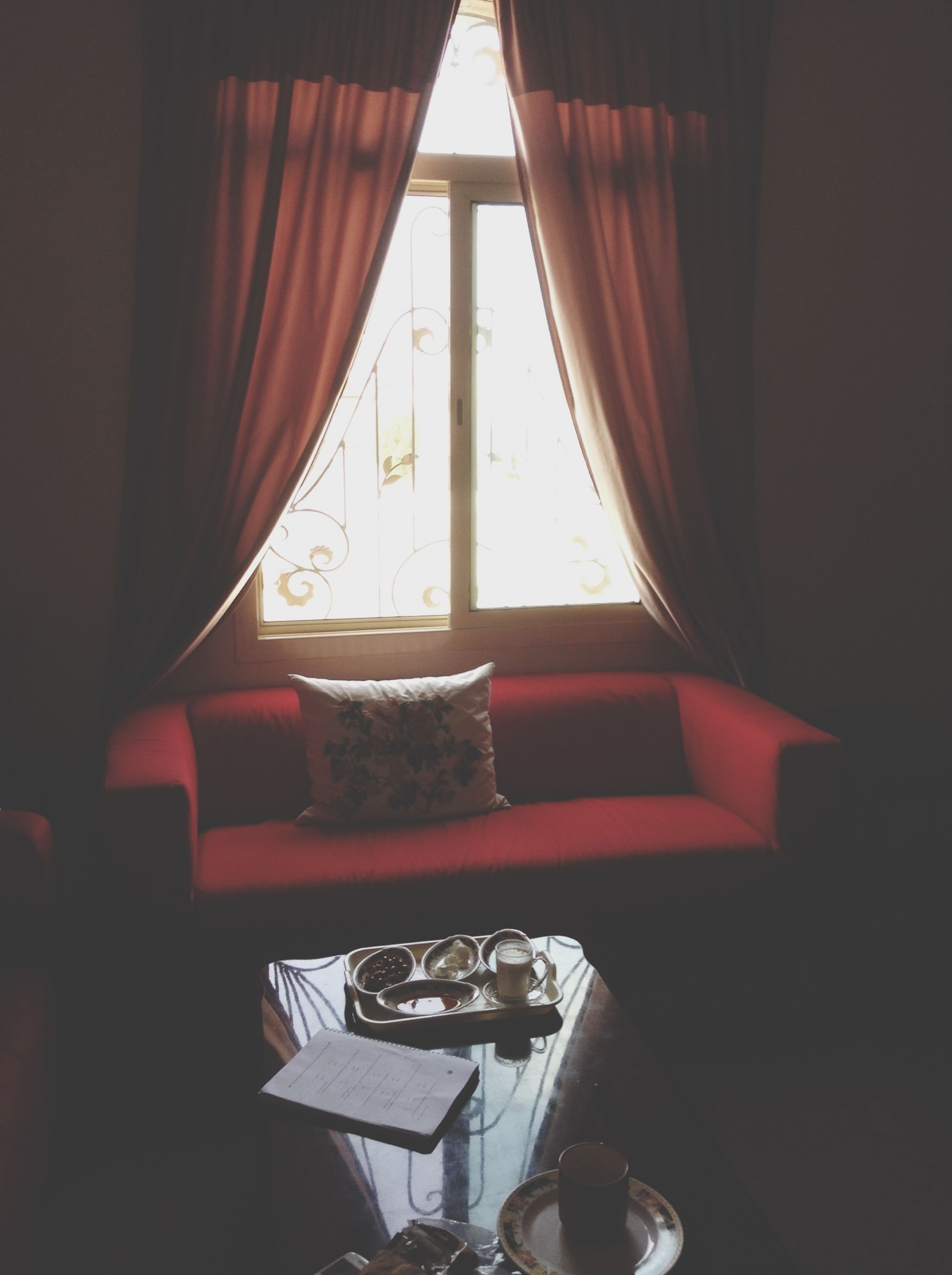 indoors, window, glass - material, transparent, home interior, table, curtain, chair, hanging, absence, glass, built structure, no people, day, electric lamp, interior, house, empty, reflection, sunlight