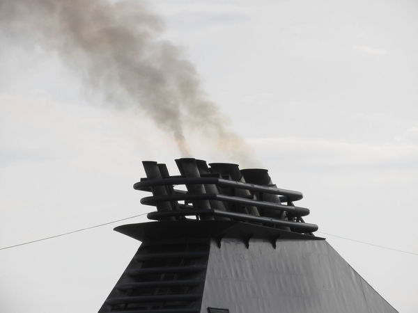 Ships funnel emitting black smoke in the sky Black Burn Carbon Chimney Dirty Energy Engine Environmental Exhaust Flue Funnel Pollute Polluting Pollution Power Ruise Ship Shipping  Smog Smoke Smokestack Stack Steam Steamer Vessel