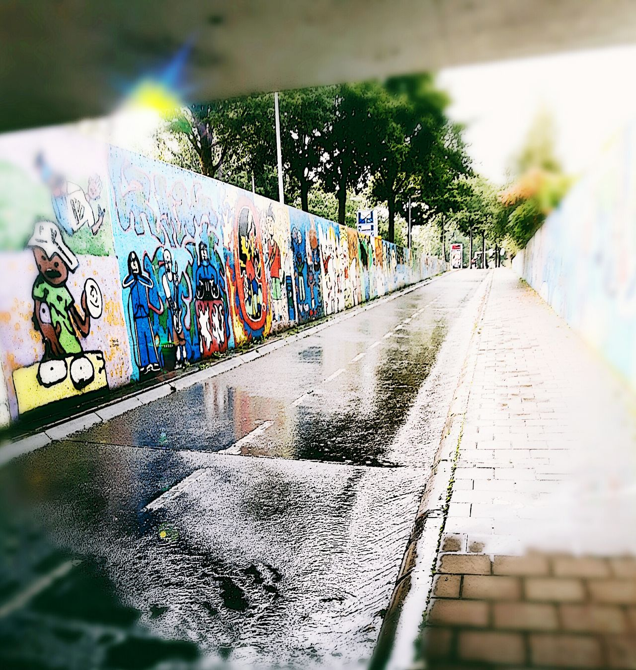 Season  Wet Weather Window Glass - Material Rain Selective Focus Concrete Pedestrian Walkway Multi Colored Creativity Purity Scool School Graffiti