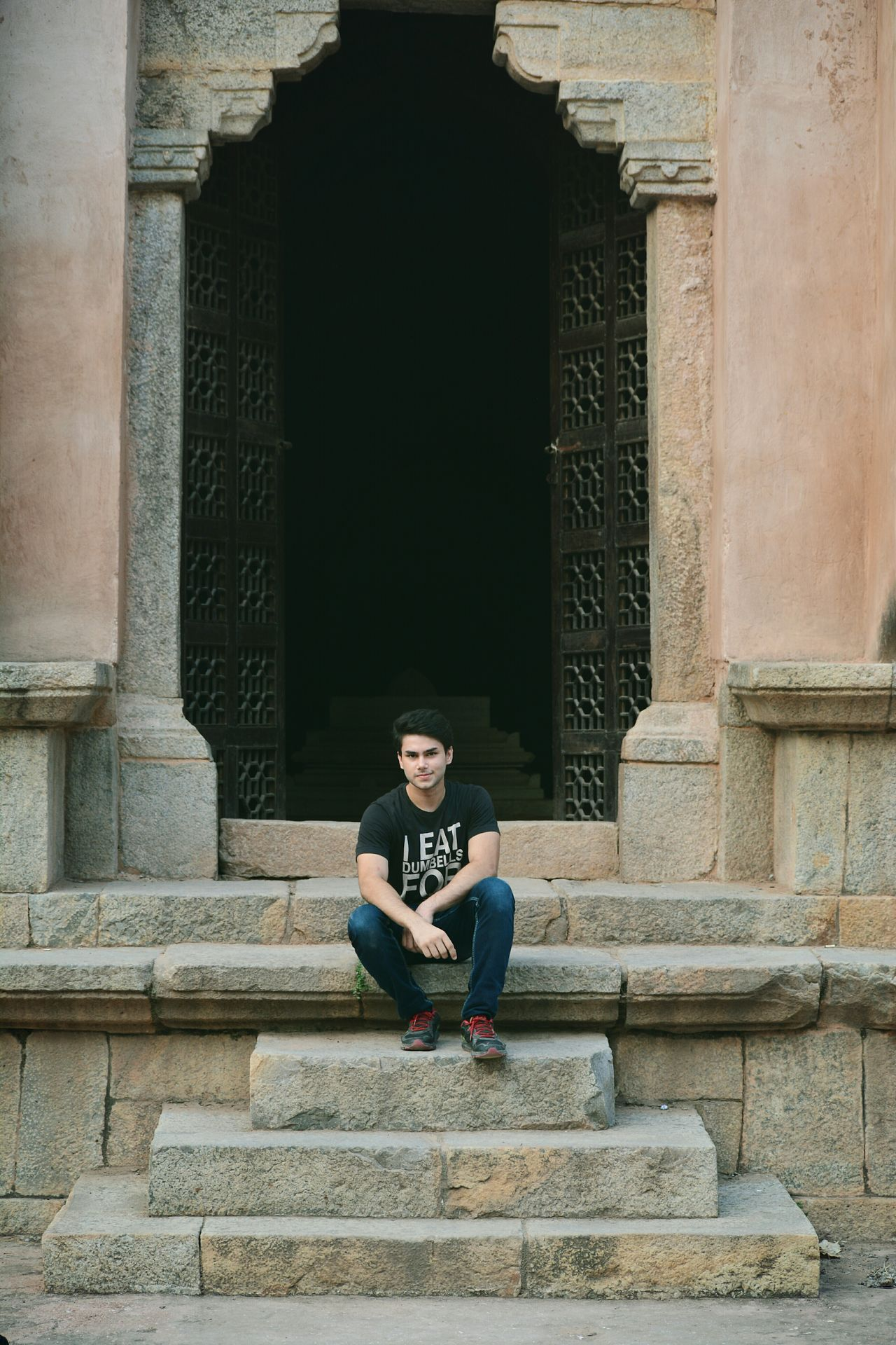 Sitting Casual Clothing Full Length Architecture Looking At Camera Person In Front Of Leisure Activity Place Of Worship History Outdoors Day Architectural Column India Indiapictures Hauzkhasfort Hauzkhasvillage Sitting Casual Clothing Building Exterior Full Length Architecture Looking At Camera Person Portrait