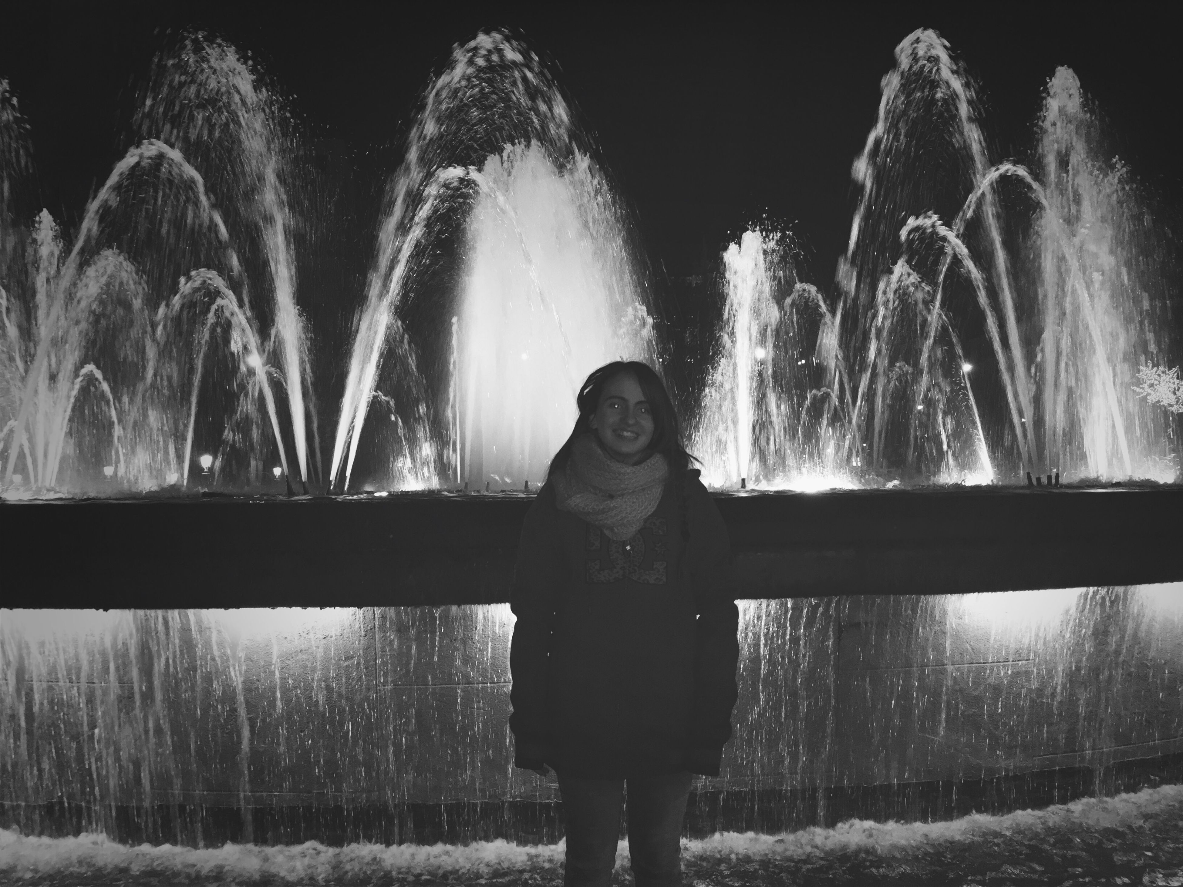 lifestyles, standing, leisure activity, fountain, water, clear sky, spraying, motion, three quarter length, night, young adult, front view, long exposure, casual clothing, tree, splashing, portrait, young women