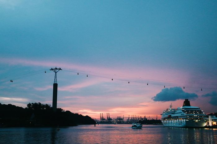 Before heading into sentosa.Canonimagingasia Canonimagingacademy Canon VSCO 18135mm CanonSG Canonphotography Canon 70d Canonasia Water Beauty In Nature Outdoors Night Sky Nautical Vessel Transportation Gondola - Traditional Boat Waterfront Sunset Scenics