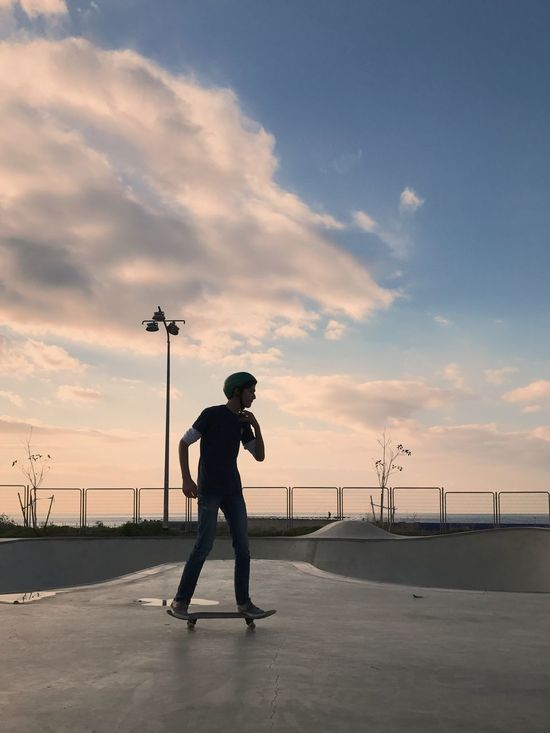Full Length Sky Cloud - Sky Skateboard Leisure Activity One Person Men Sunset Outdoors Skateboard Park Standing Real People One Man Only Headwear Shotoniphone7plus מייאייפון7 IPhone7Plus מייסקייט The Street Photographer - 2017 EyeEm Awards
