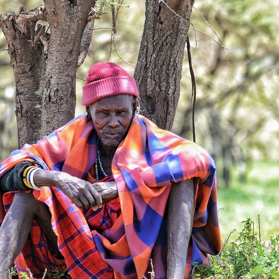 The leader of a Masai village watches us carefully as we enter his settlement, in the Serengeti. Masai Tribe Masaiwarrior Tanzania Serengeti National Park Tribe One Person Portrait Leadership People Senior Men Men Adult Africa African Traveltheworld Travel Destinations Traveladdict Nomadic Lifestyle NOMAD EyeEmNewHere Local Culture Local People Outdoors One Man Only Portraits