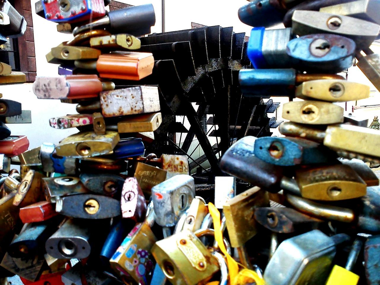 large group of objects, abundance, padlock, metal, love lock, lock, variation, love, no people, close-up, outdoors, day, hanging, multi colored, hope