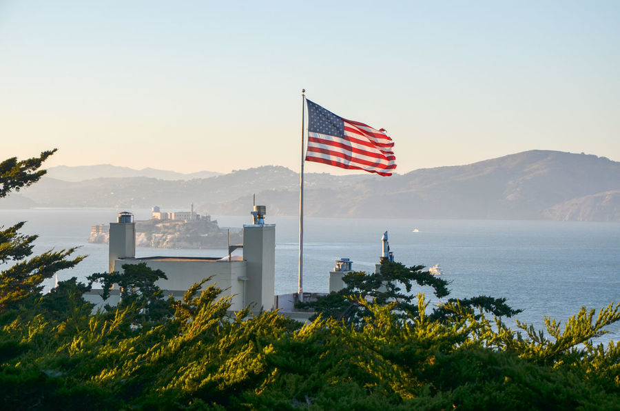 Alcatraz Alcatraz Island Beauty In Nature California Clear Sky Day Flag Flag Pole Freedom Mountain Nature No People Outdoors Patriotism San Francisco Sky Stars And Stripes Striped Tree United States