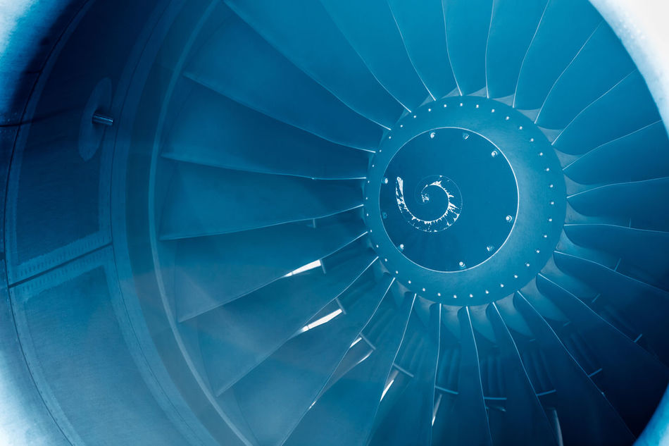Close Up on a huge jet engine with blue filter and light leaks Aeroplane Air Aircraft Airliner Airplane Airport Aviation Blades Blue Business Case Close-up Closeup Commercial Detail Engine Fly Huge Jet Light Leaks Modern Plane Transportation Travel Turbine