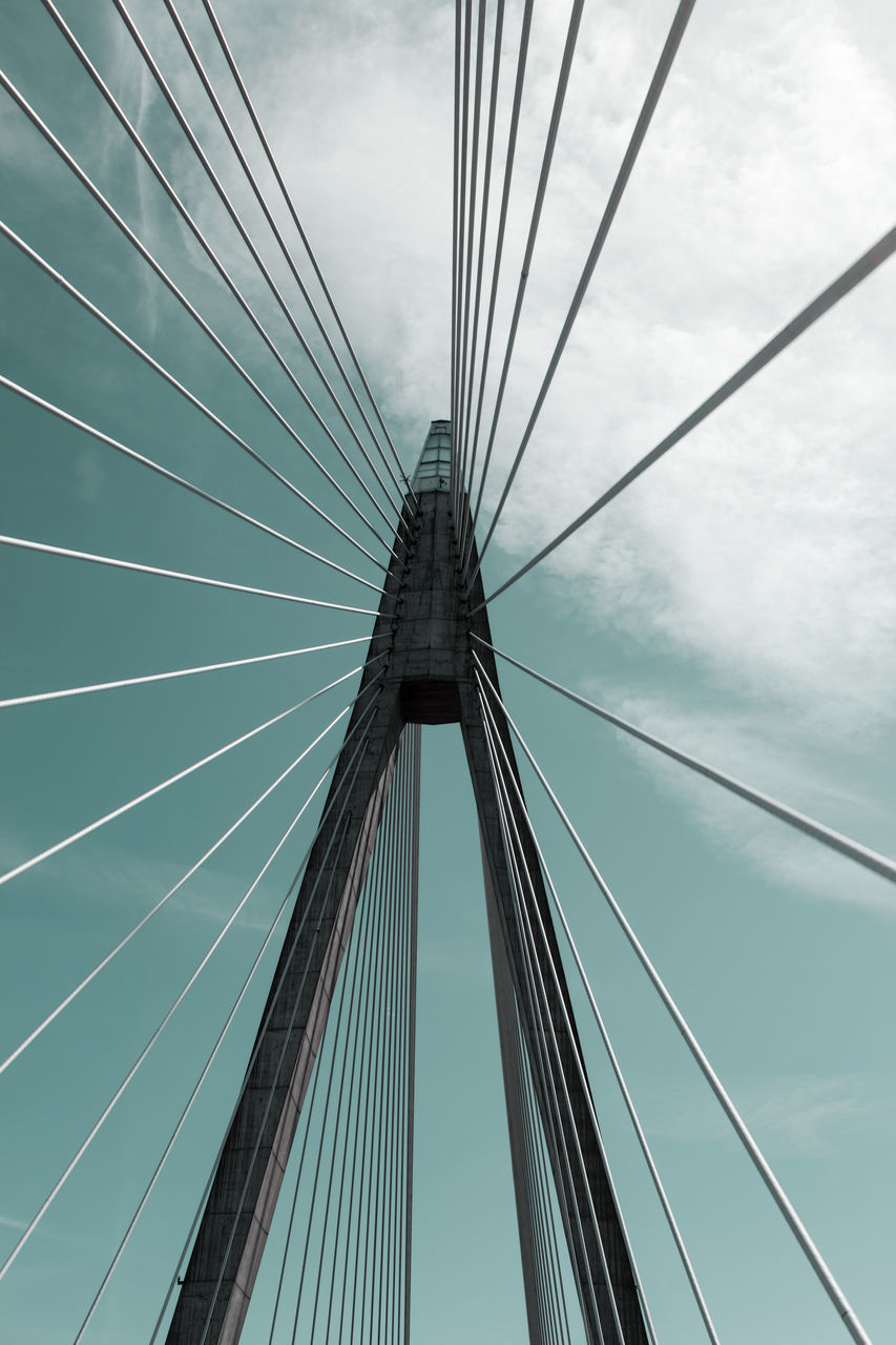 connection, suspension bridge, bridge - man made structure, engineering, cable, sky, transportation, architecture, low angle view, built structure, outdoors, day, no people, bridge, line, city