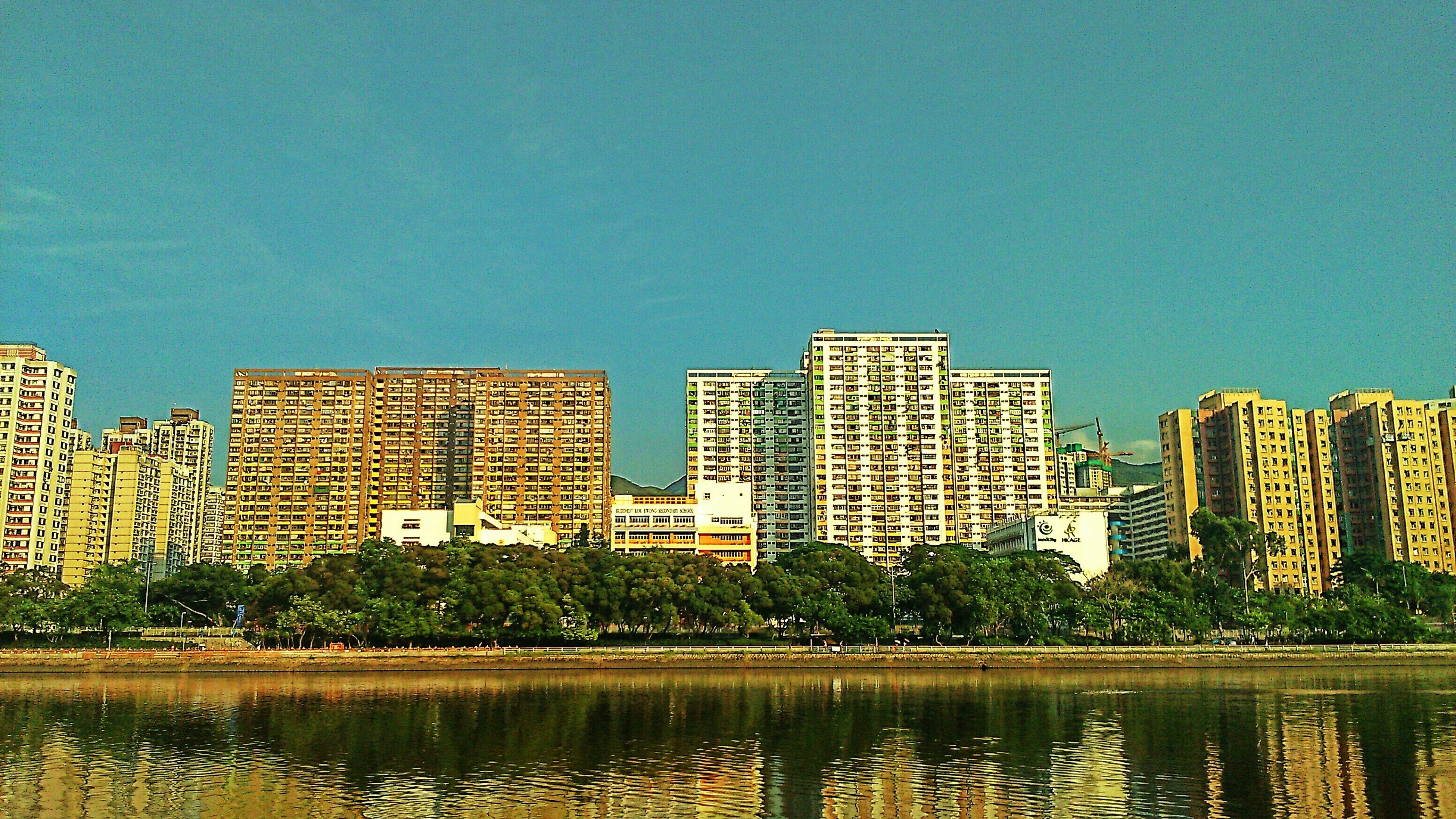 architecture, clear sky, building exterior, built structure, water, copy space, blue, reflection, waterfront, city, river, building, cityscape, lake, no people, residential structure, modern, outdoors, window, residential building