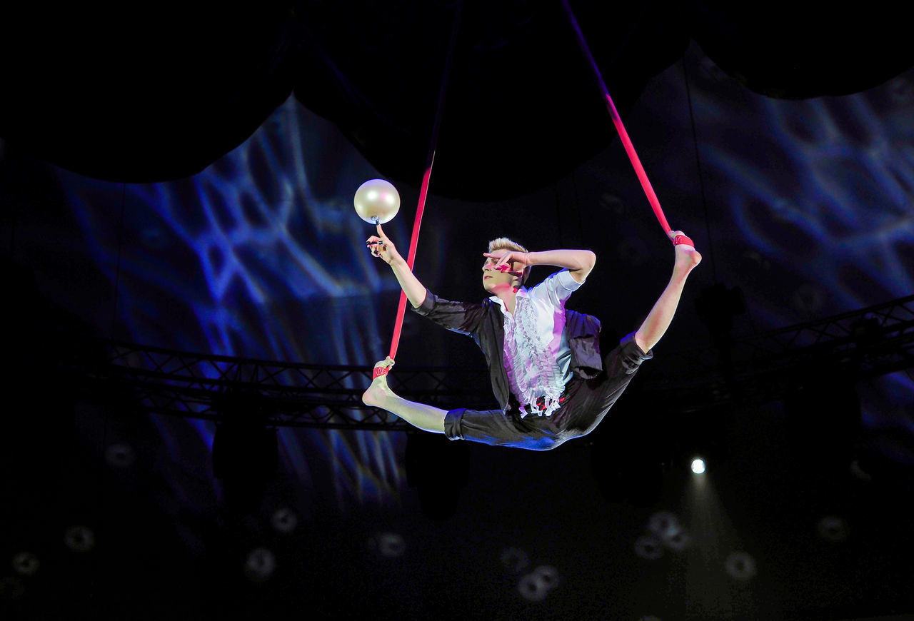 Russia, Moscow, circus, Russian circus, Circus, juggler, juggler in the air Adult Adults Only Black Background Circus Full Length Indoors  Juggler In The Air Mid-air Moscow Night One Person One Woman Only Only Women People Russia Russian Circus