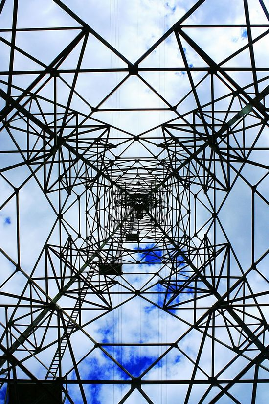 Inside a giant Pylons And Powerlines that cross the Riversevern Looking Up