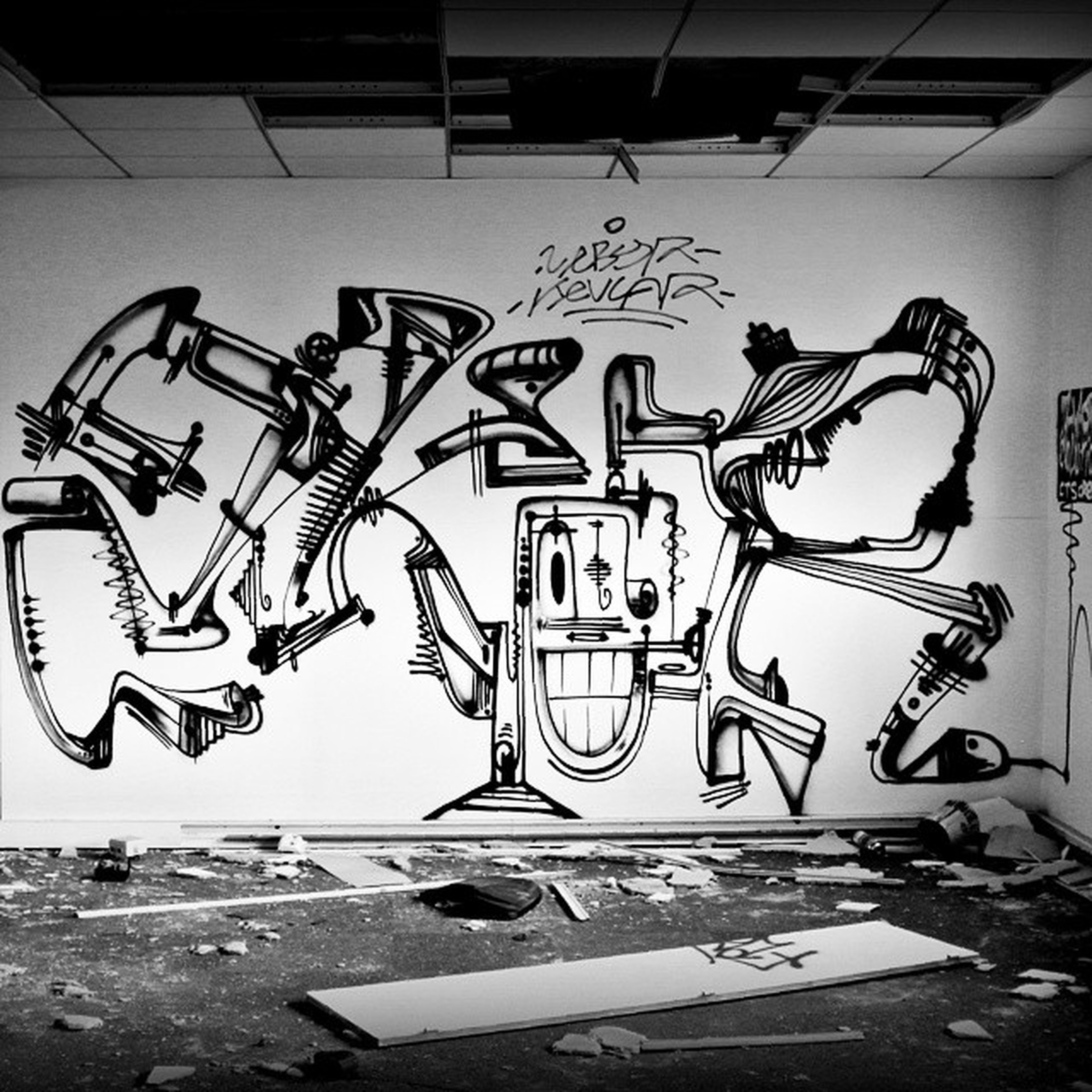 graffiti, text, art, western script, creativity, art and craft, communication, human representation, wall - building feature, built structure, bicycle, architecture, sign, street art, capital letter, street, transportation, day, road