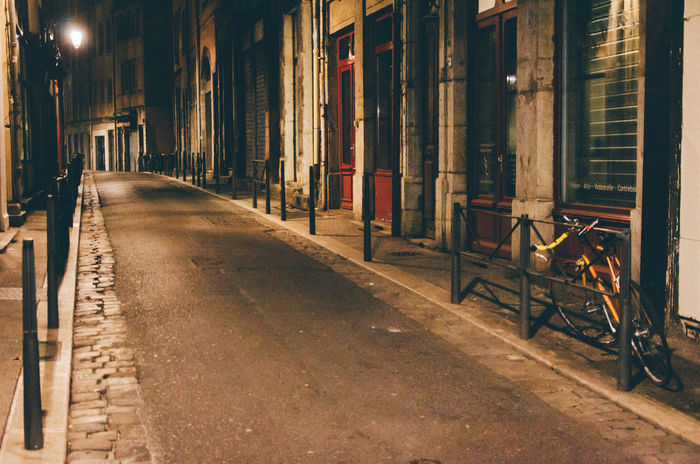 Architecture Bike Building Exterior Built Structure City Closed Illuminated Light Night No People Outdoors Parked Pavement Shop Street The Way Forward The Street Photographer - 2017 EyeEm Awards The Great Outdoors - 2017 EyeEm Awards