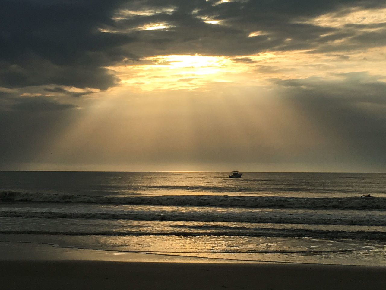 Heaven's rays over ocean Beach Beauty In Nature Cloud - Sky Day Horizon Over Water Idyllic Nature No People Outdoors Reflection Scenics Sea Silhouette Sky Sunlight Sunset Tranquil Scene Tranquility Water Wave