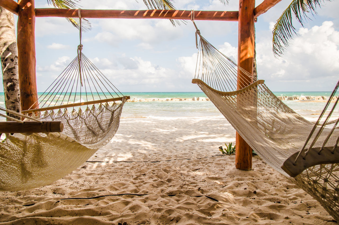 Two hammocks dangling in the wind on a nice sunny beach #hammock #lazy #lazyday #view Beach Beauty In Nature Cloud - Sky Day Horizon Over Water Nature No People Outdoors Sand Scenics Sea Sky Tranquil Scene Travel Destinations Water