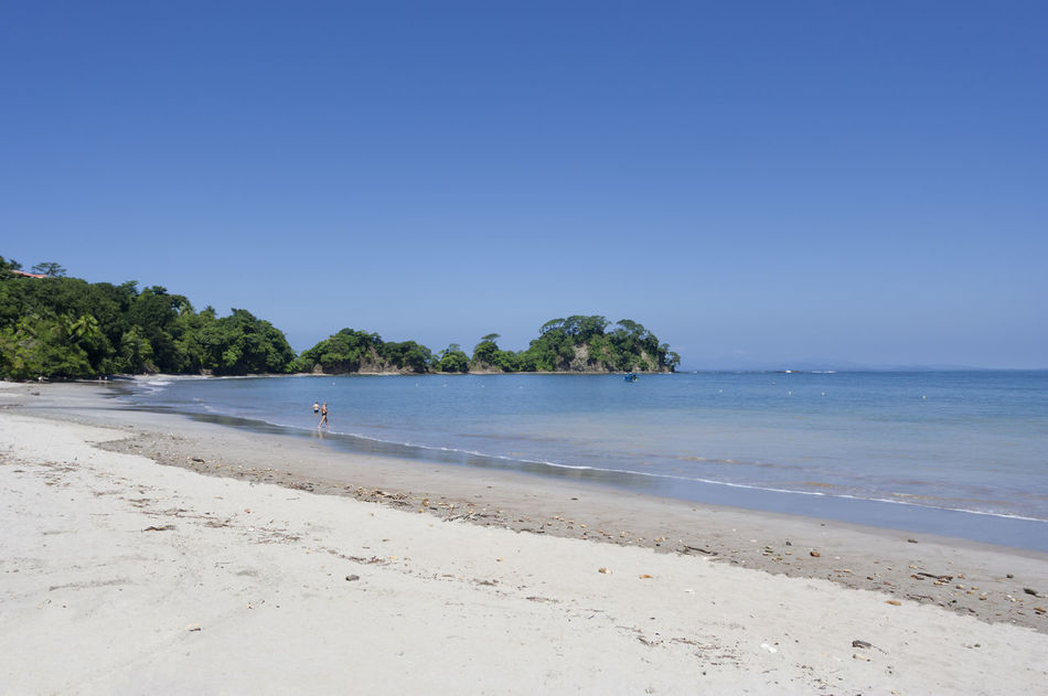 Beach in Punta Leona, Costa Rica. This pristine white sand beach is surrounded by lush primary and secondary forests. Beach Beach Day Beach Photography Beachlife Beauty In Nature Costa Rica Horizon Over Water Nature Pacific Ocean Panorama People Punta Leona Puntarenas Sand Scenics Sea Tourism Tranquil Scene Travel Destinations Tropical Tropical Climate Tropical Paradise Vacations Water White