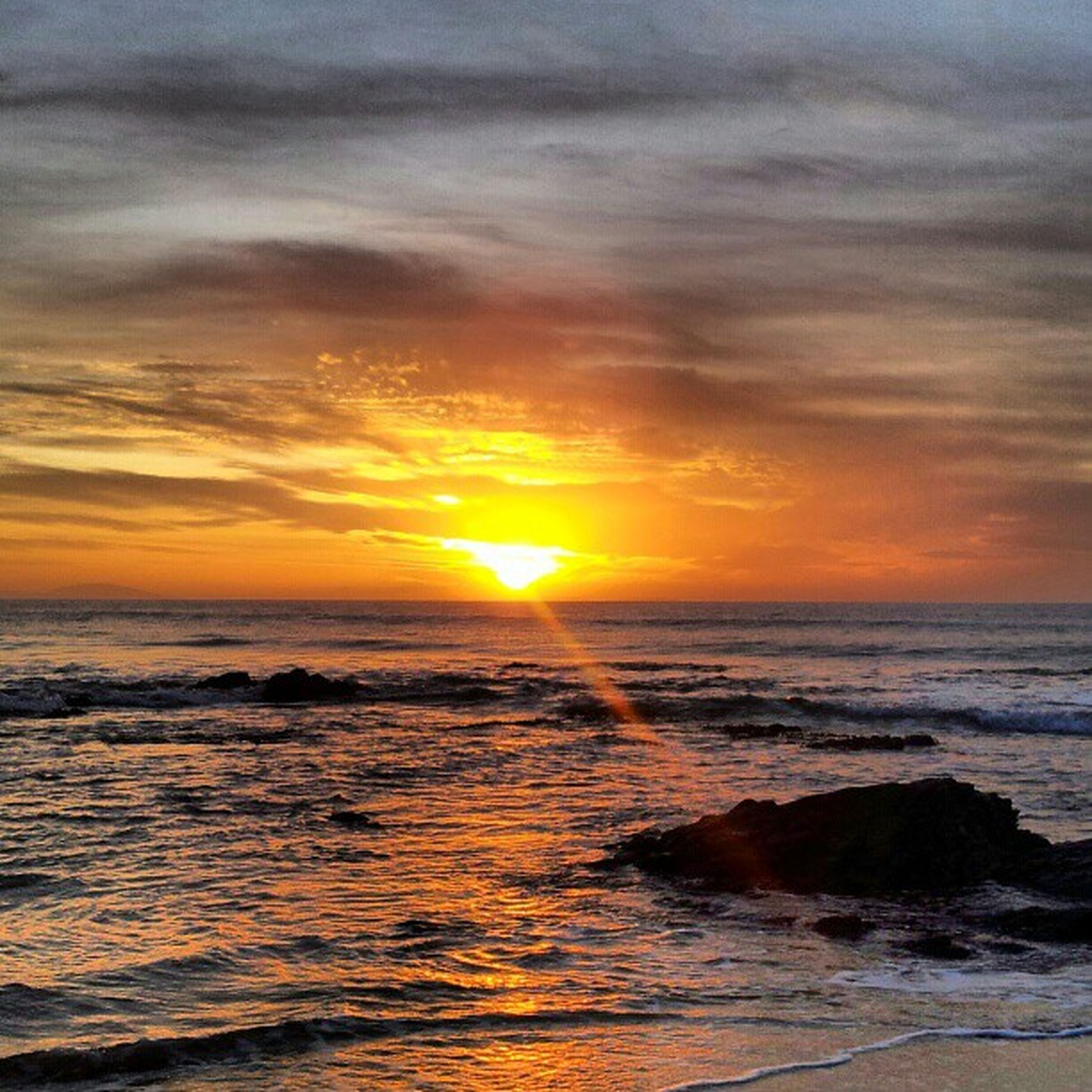 sunset, sea, water, horizon over water, scenics, beauty in nature, sky, tranquil scene, orange color, tranquility, beach, sun, wave, nature, idyllic, cloud - sky, shore, rock - object, outdoors, surf