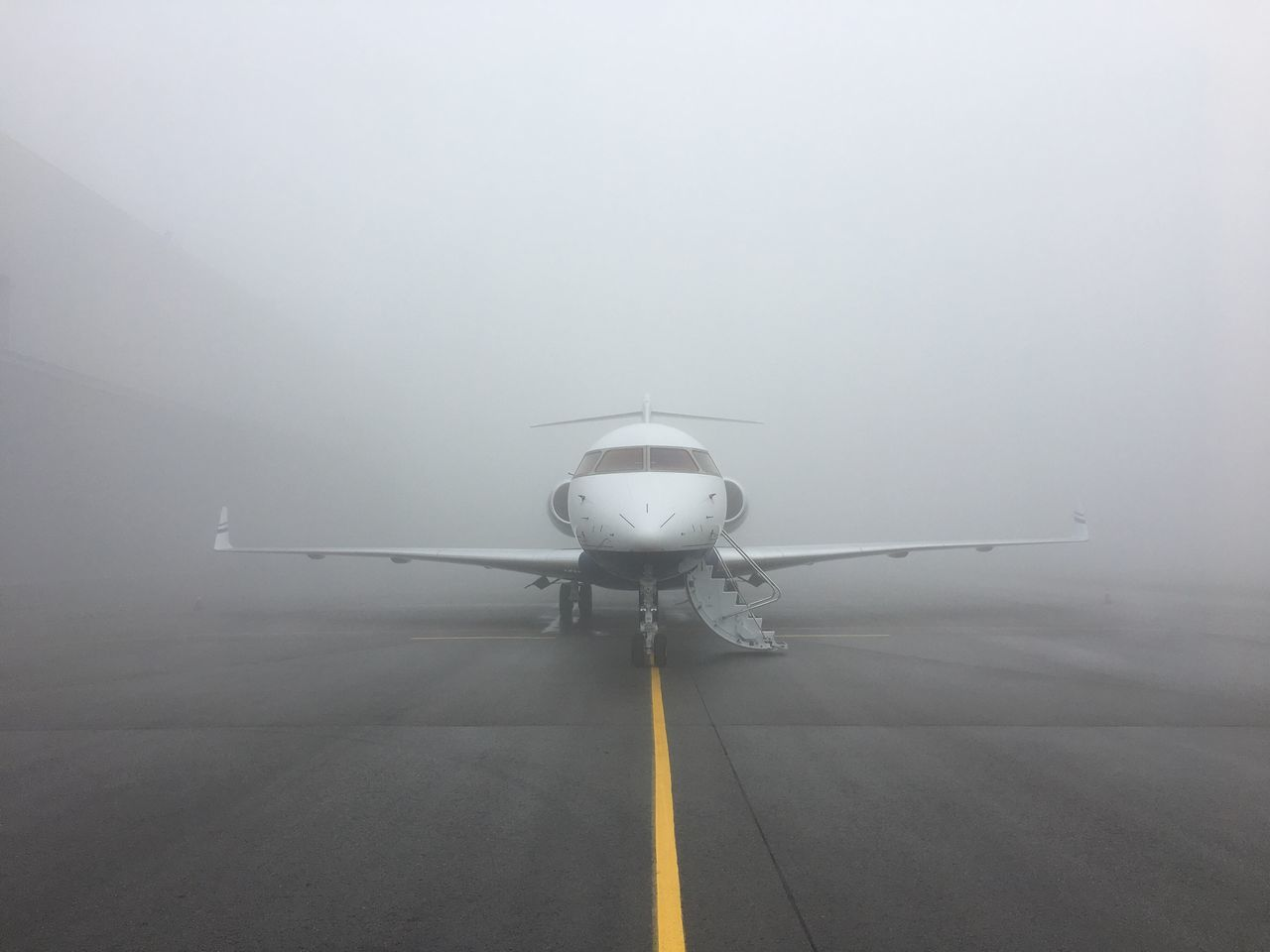 Airplane Transportation Air Vehicle Airport Airport Runway Runway No People Day Nature Outdoors Passenger Boarding Bridge Fog