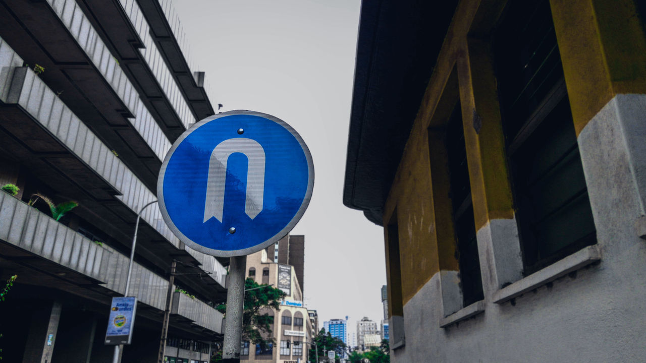 Symbol Road Sign Guidance Building Exterior Blue Day Built Structure No People Outdoors Sky Abstract EyeEm Detail Street Art EyeEm Best Shots Low Angle View Streetphotography Canon Camera Canonphotography Africa EyeEm Gallery The Street Photographer - 2017 EyeEm Awards