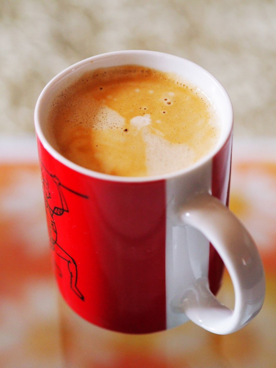 Close-Up Of Coffee In Mug On Table
