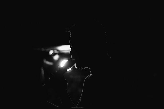 In BW Illuminated Dark Night Blackandwhite EyeEm Best Shots - Black + White Black And White Monochrome Photography EyeEm Best Shots Portrait Candid Silhouette Outdoors Live Music Enjoyment Lifestyles