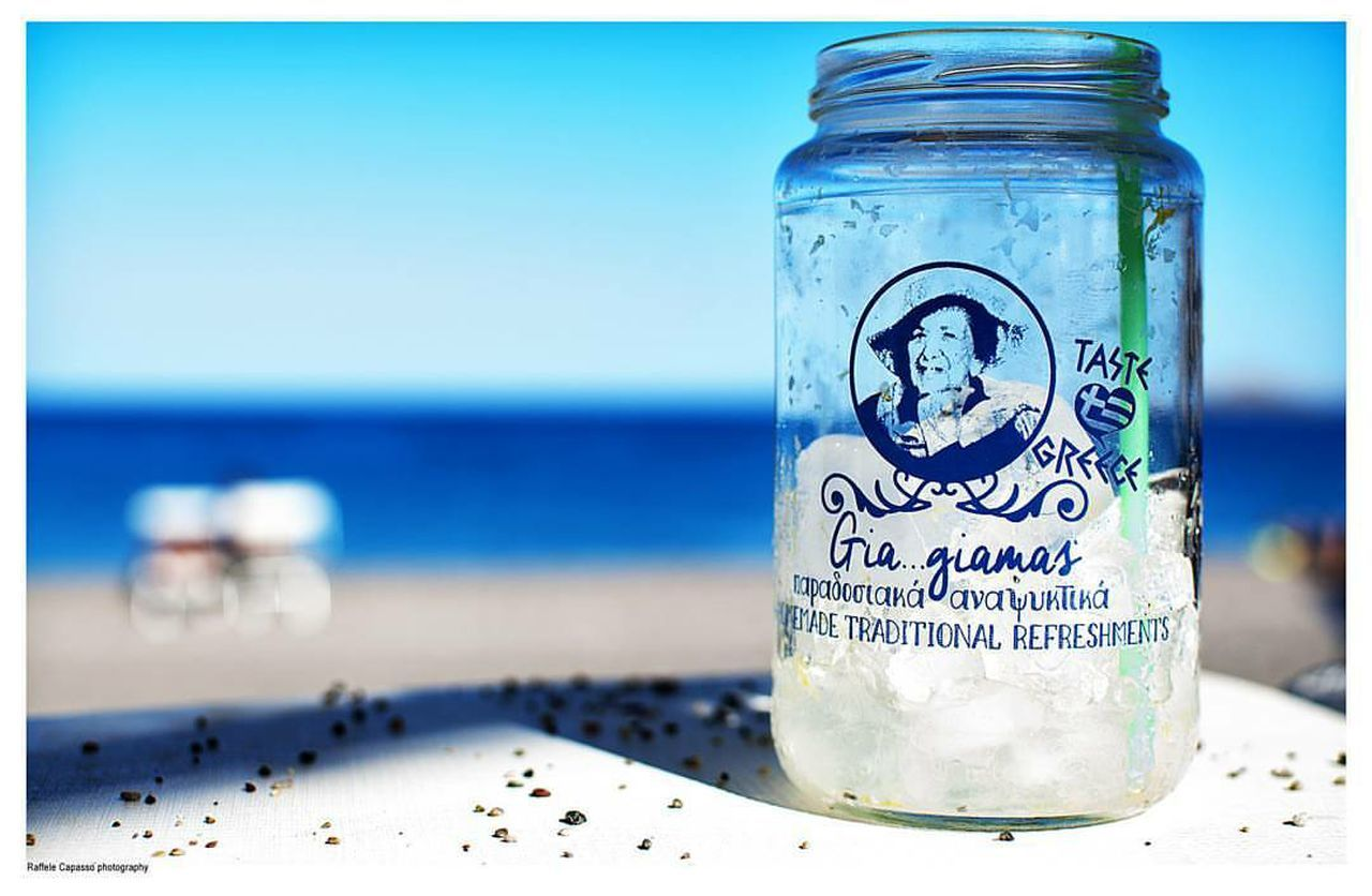 jar, blue, focus on foreground, close-up, no people, beach, indoors, day