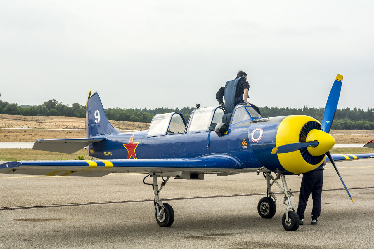 airplane, air vehicle, transportation, fighter plane, air force, pilot, old-fashioned, day, military airplane, military, airport runway, outdoors, one person, aerospace industry, sky, airshow, people