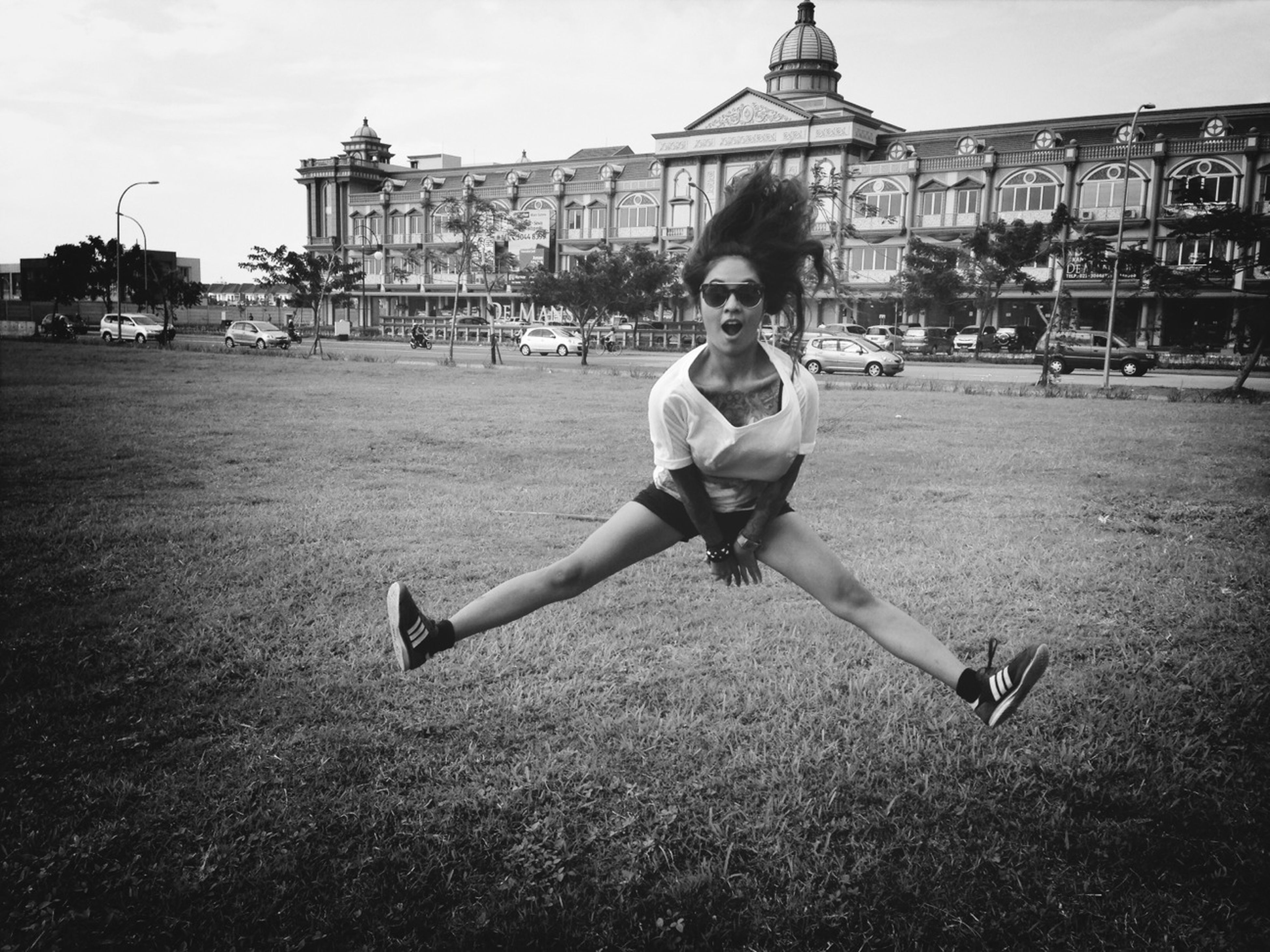 childhood, lifestyles, person, leisure activity, full length, elementary age, casual clothing, boys, building exterior, built structure, architecture, girls, happiness, fun, playing, grass, mid-air, enjoyment