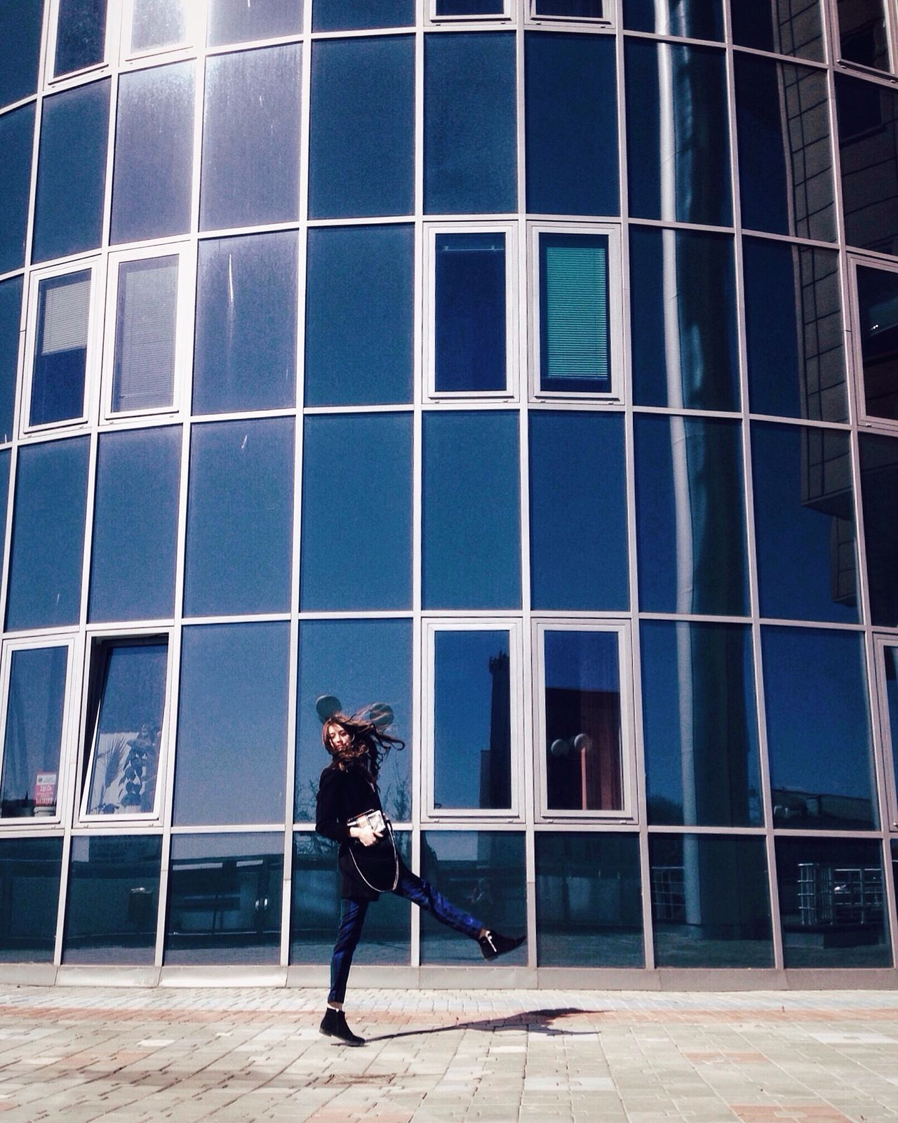 Happy woman walking on the street Full Length One Person Young Adult City Architecture One Woman Only Fashion&love&beauty Fashion Photography Fashion Windy Jumping