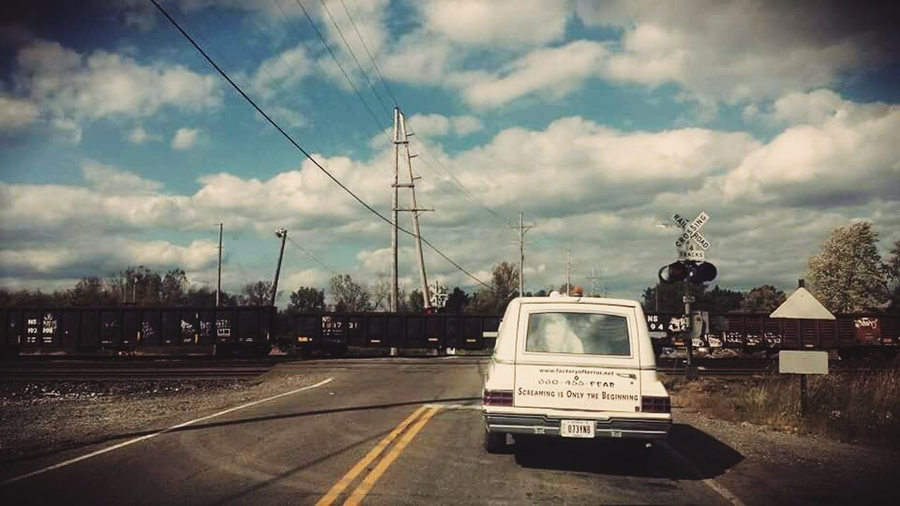 transportation, sky, cloud - sky, mode of transport, road, land vehicle, day, outdoors, cable, no people, electricity pylon