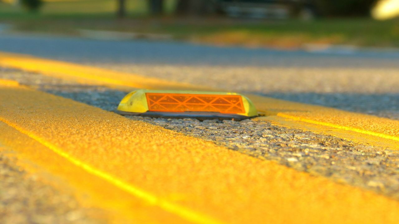 Close-up No People Outdoors Water Day Beauty In Nature On The Street Road Roadtrip Yellow Yellow Line Yellow Lighting Yellow Color Daytime Daylight Focus On Foreground Focused Up Close Street Photography Streetphotography Up Close And Personal