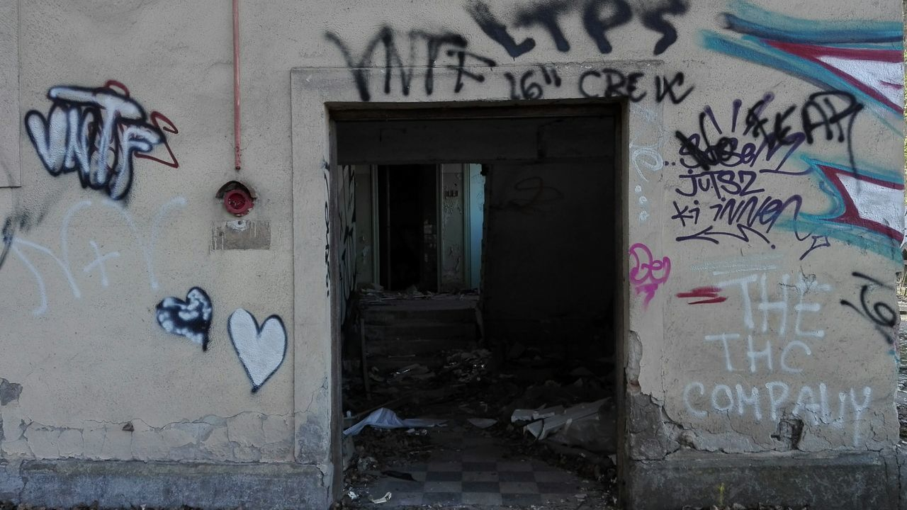 graffiti, text, built structure, architecture, door, abandoned, communication, no people, day, building exterior, indoors, close-up