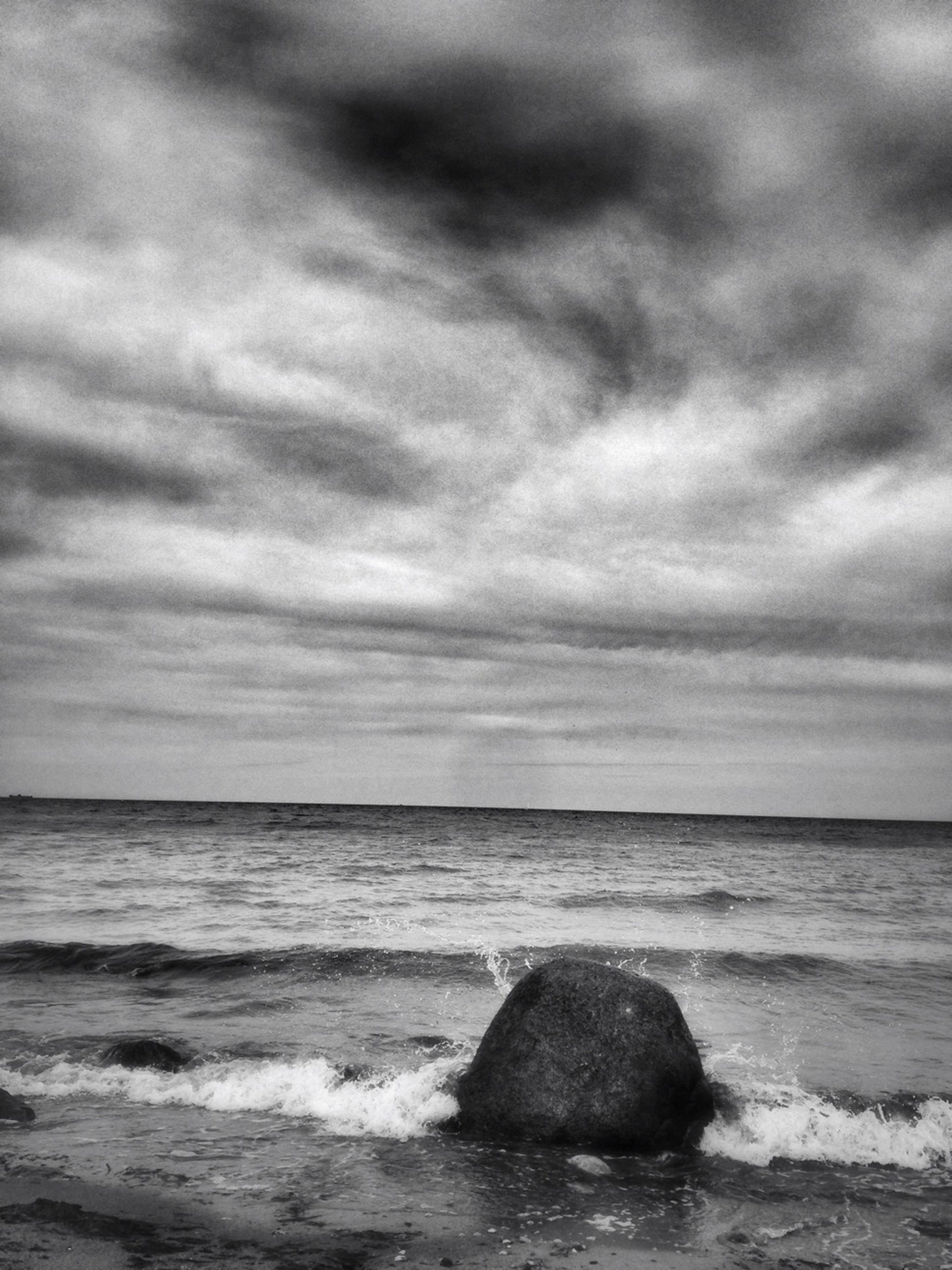 sea, horizon over water, water, sky, scenics, wave, beach, beauty in nature, tranquil scene, cloud - sky, shore, surf, tranquility, nature, cloudy, rock - object, idyllic, cloud, overcast, outdoors